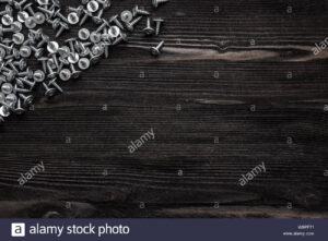 Some Wood Crews On Dark Wooden Desk Board Surface. Top View for Borderless Certificate Templates